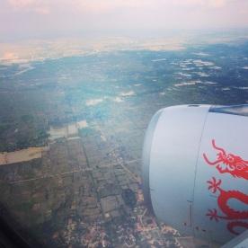 Airplane Wing Arriving Cambodia, Travel Blog, Travel Writing, LisaDeviAdventure, Lisa Kazmer, Lisa Devi, Ankor Wat, Traveler, Traveling, Southeast Asia, Spiritual Travel